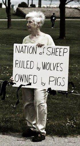 granny-demonstrates-against-human-wolves-sheep-pigs