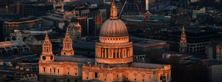 St Paul's cathedral is lit by the early morning sun in an aerial view taken from The View gallery at the Shard, western Europe's tallest building, in London