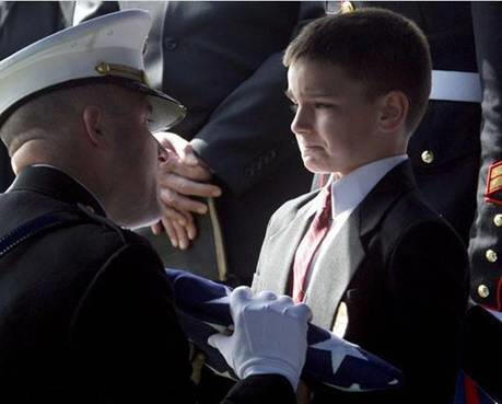 Marine-handing-boy-flag-at-funeral