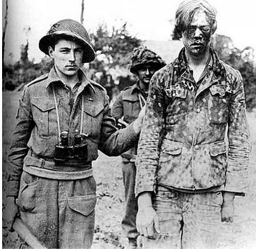 brit-soldier-1945-badly-face-beaten-german-prisoner