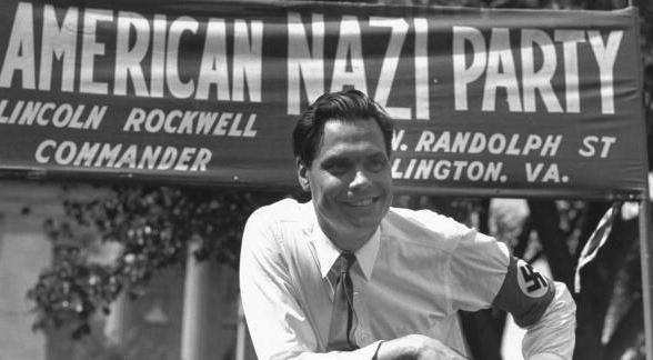 george-lincoln-rockwell-big-smile-am-nazi-party-banner