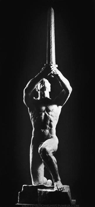 heroic-statue-half-kneeling-man-sword-upraised