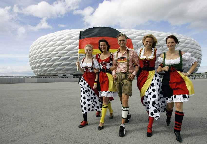 Models present traditional Bavarian Dirndl dresses in football style
