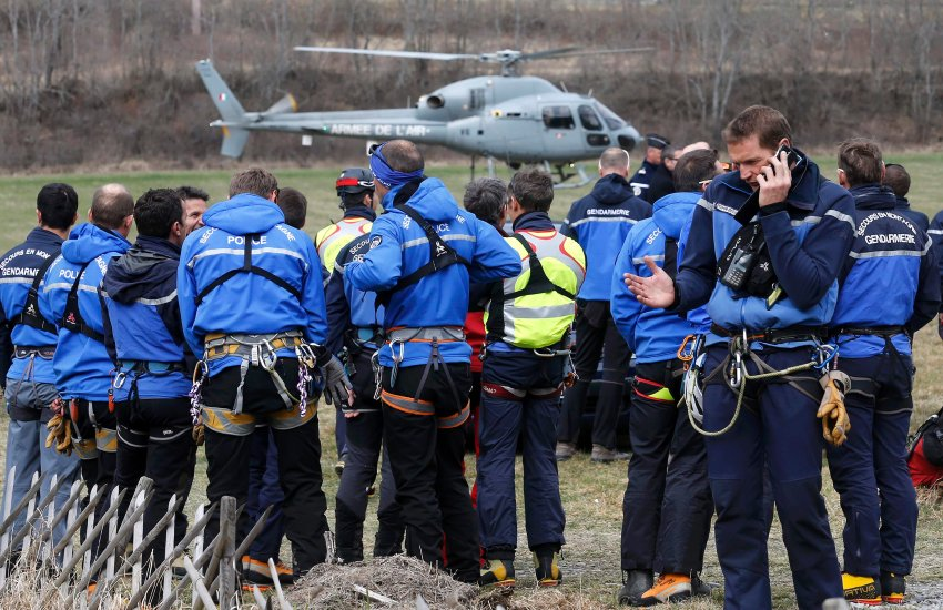 French Police and Gendarmerie Alpine rescue units gather on a field as they prepare to reach the crash site of an Airbus A320