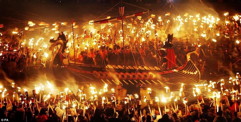 viking-ship-gets-underway-torch-bearers-before-behind