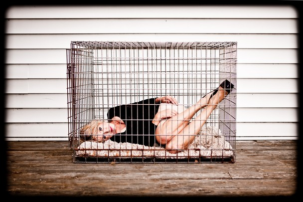 white-blonde-woman-in-cage